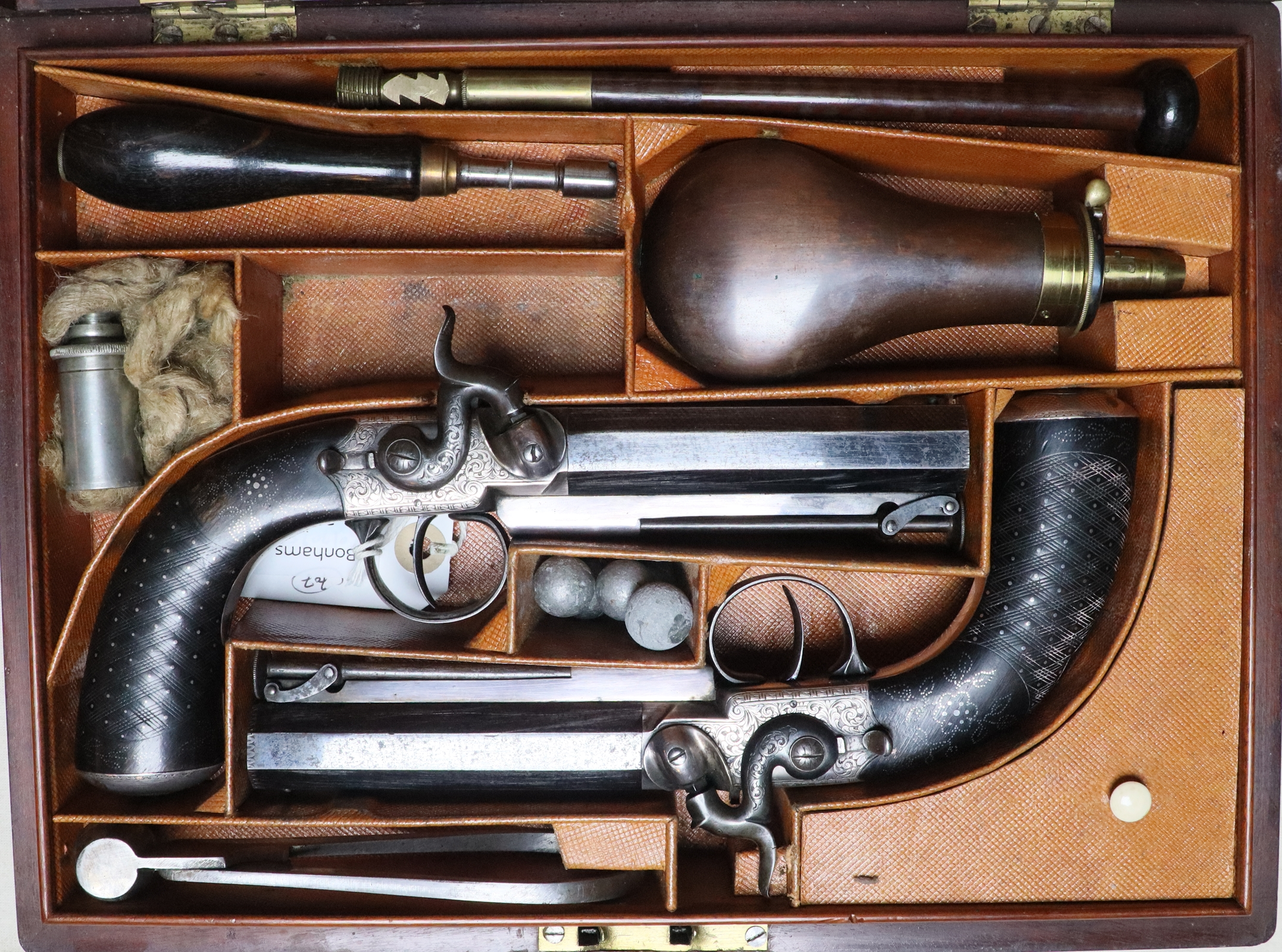 Pigskin lined case of pair of percussion pocket pistols.